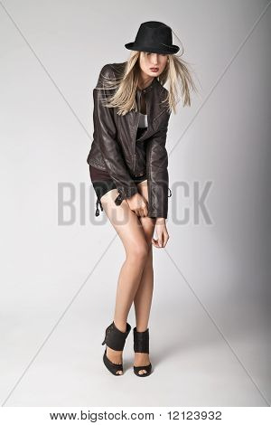 Studio photo of a cute blonde wearing leather jacket