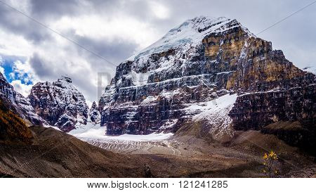 Mount Lefroy and the Mitre under Cloudy skies viewed from the trail to the Plain of Six Glaciers in Banff National Park in the Canadian Rockies