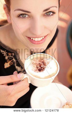 Young woman enjoying coffee break