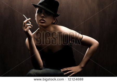 fashion style photo of a gorgeous brunette holding a cigarette