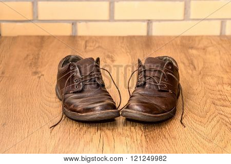 Men's Old Boots On Wood Background