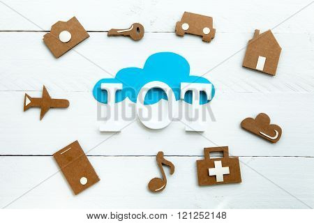 Cardboard web icons,  blue cloud and Iinternet of things acronym