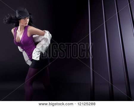 Dancing brunette beauty over abstract background