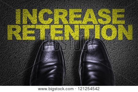 Top View of Business Shoes on the floor with the text: Increase Retention