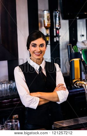 Portrait of waitress behind the counter in a bar