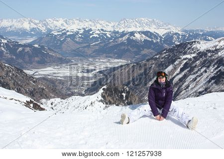 Young Woman Have A Rest On The Ski Slope.