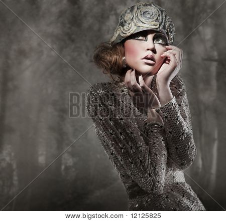 beautiful young lady in a mysterious gray forest