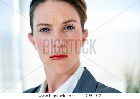 business woman staring at the camera