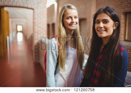 Smiling students in the hallway at university