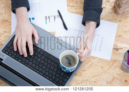 Close Up Of Woman Hands With Reporting And Pen, Coffee