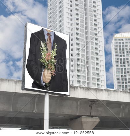 Business Man Hand Hold A Flowers Bouquet On