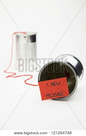 conceptual representation of sending messages via mobile phones using tin cans.