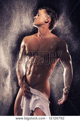 Muscular guy having bath