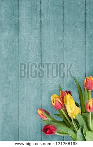 Bouquet Of Tulips On Blue Wood Plank Background