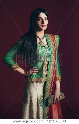 Retro Bollywood Fashion Woman Against Dark Red Background.