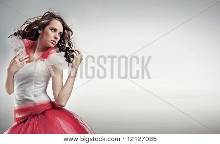 Pretty brunette posing, lots of copy space