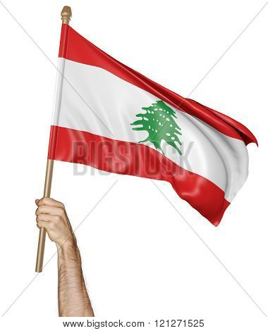 Hand proudly waving the national flag of Lebanon