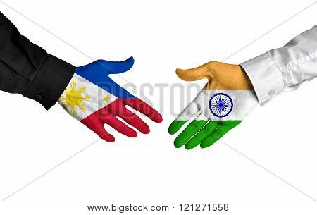 Philippines and India leaders shaking hands on a deal agreement