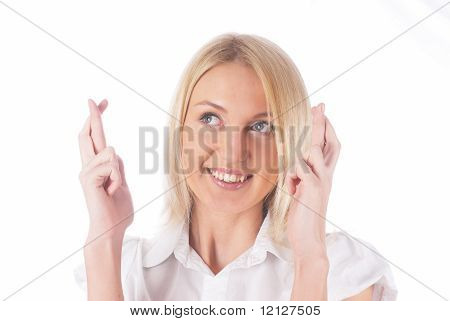 Girl with crossed fingers