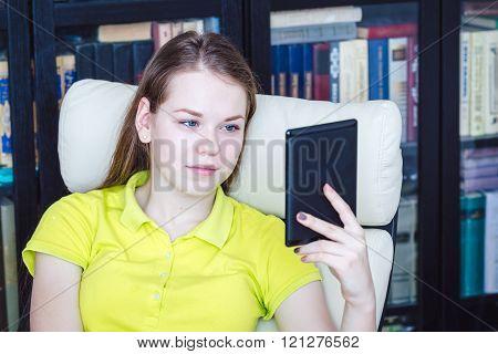A girl reads the e-book