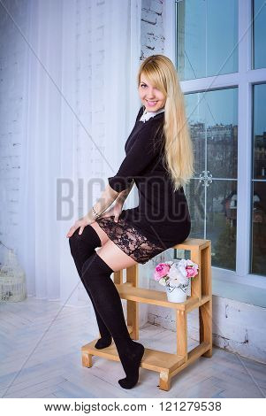 woman sitting on the stepladder