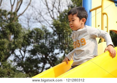 Japanese boy on the slide (6 years old)