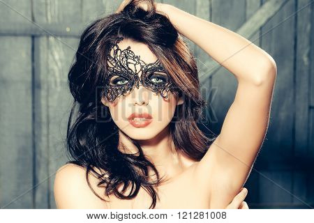 Woman In Lace Mask