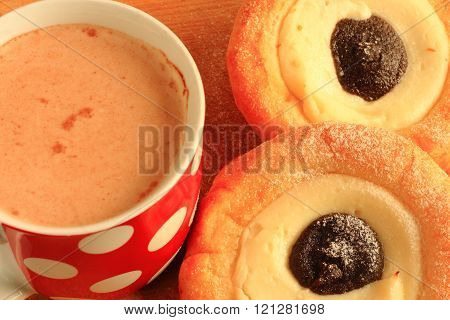 Two Cakes With Cottage Cheese And Cup With White Polka Dots