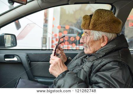 Senior In A Car