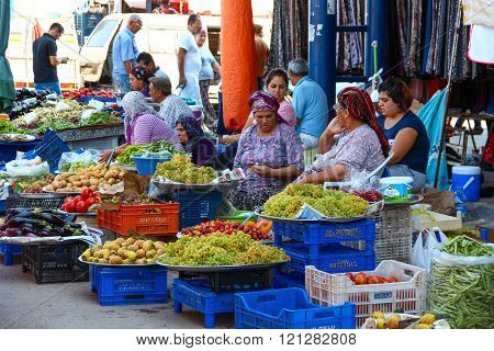 ANTALYA, TURKEY - Aug 14 2012, View of a traditional street markets where old and young women sellin