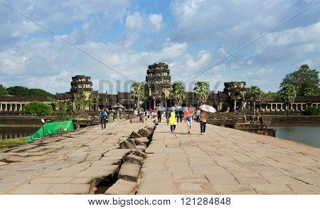 Siem Reap, Cambodia - December 2, 2015: People Visit Ruined Towers On The West at Angkor Wat