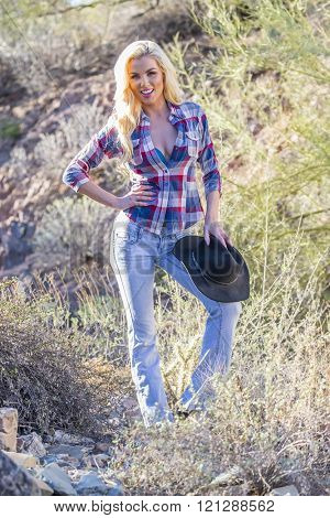 A blonde model posing in the desert of the American Southwest
