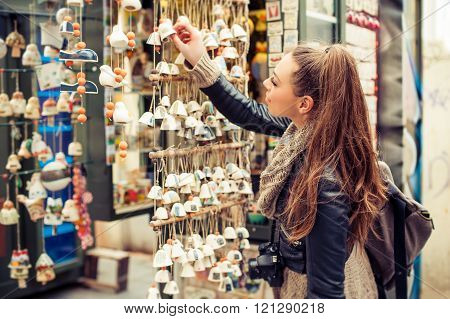 Woman buying souvenirs