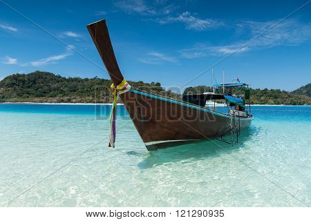 Long Tailed Boat On The Sand Beach