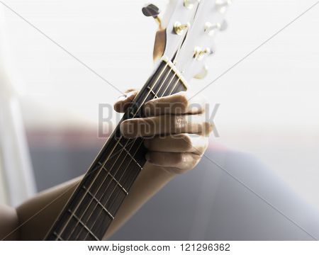 Unidentified Male Play Guitar With Left Arm Closeup With Sunlight
