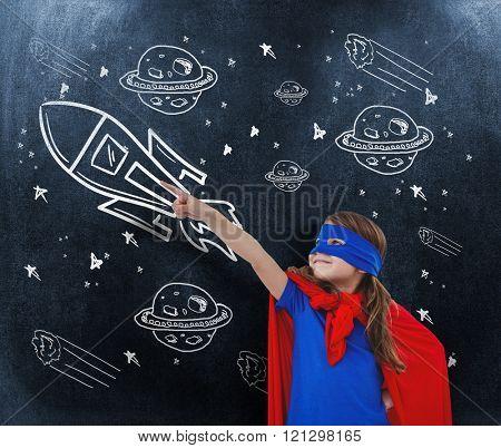 Masked girl pretending to be superhero against black background