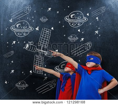 Masked kids pretending to be superheroes against black background