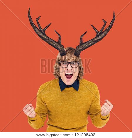 Portrait of hipster shouting against red background