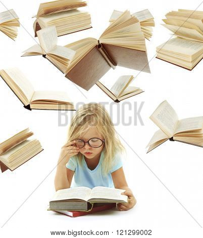 Cute little girl reading book and flying books isolated on white