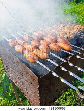 Sausage Fried On A Barbecue Brazier