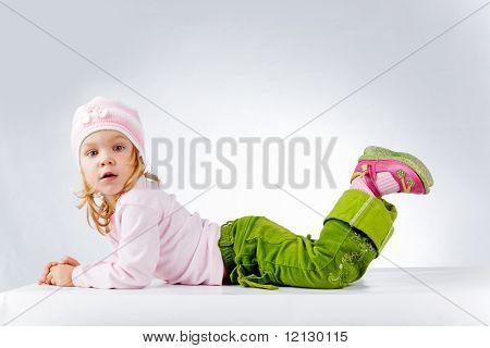 Little funny girl on white background studio shot