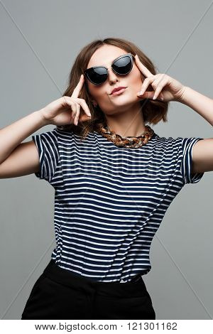 amazing woman wear blue outfit,fashionable. Large Round Sunglasses.