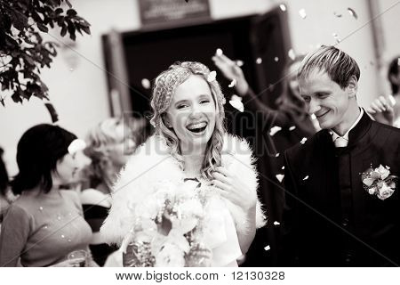 Laughing bride and groom during wedding ceremony