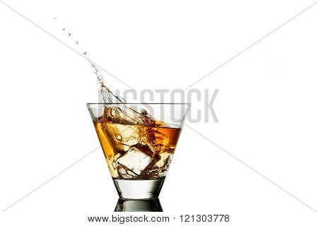 whisky splash in glass isolated on a white background