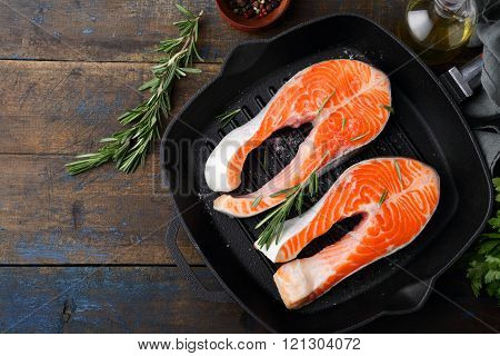 Salmon Steak On A Griddle Pan. Cooking Red Fish