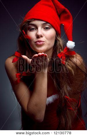 Santa helper girl giving a kiss to you