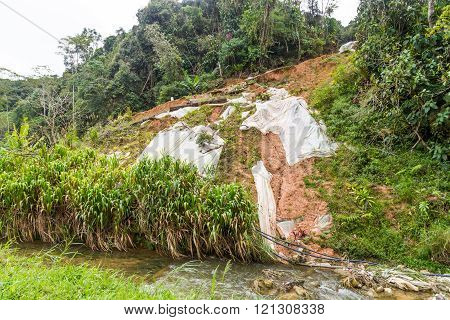 Huge Plastic Sheets Used To Temporarily Halt Slope Soil Erosion