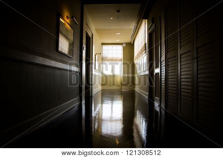 Dark And Empty Corridor With Available Natural Light From Window