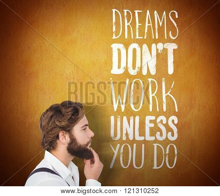 Man rubbing his beard beside words saying dreams dont work unless you do