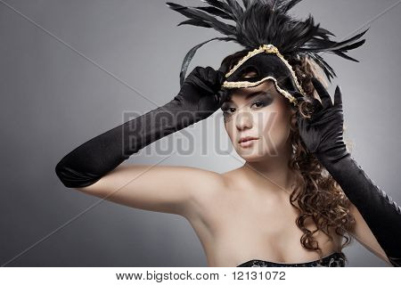 Beautiful woman wearing masquerade costume and mask
